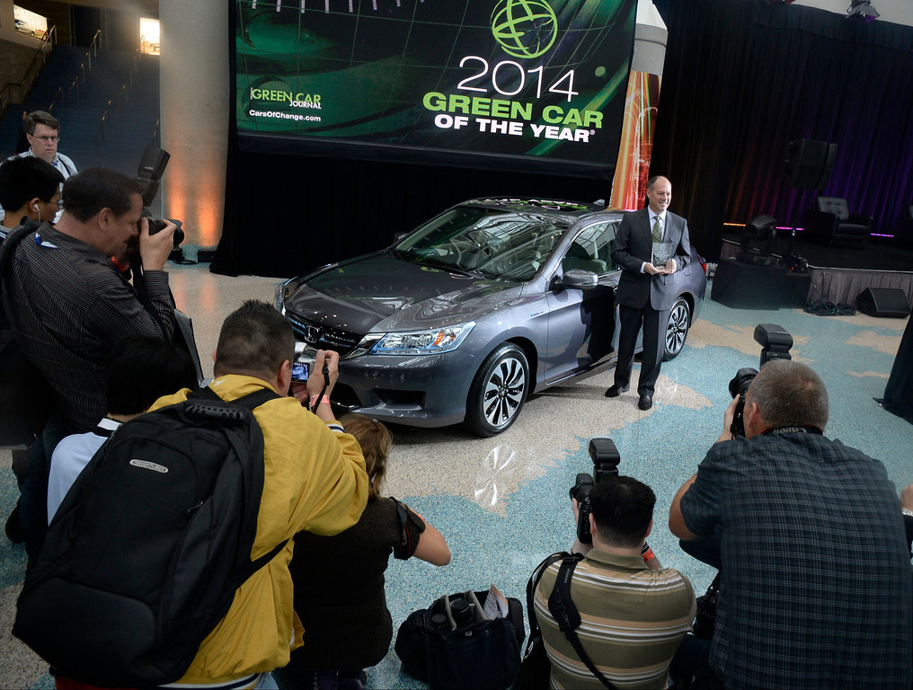 ". Nov 22,2013 Los Angeles CA. Senior VP of automotive operations of Honda America Mike Accavitti holds the award, as Honda accord  was named ""2014 green car of the year\""  on displays during the 2nd media day at the Los Angeles Auto Show. The show opens to the public today Friday and runs through Dec 1st.  Photo by Gene Blevins/LA Daily News"
