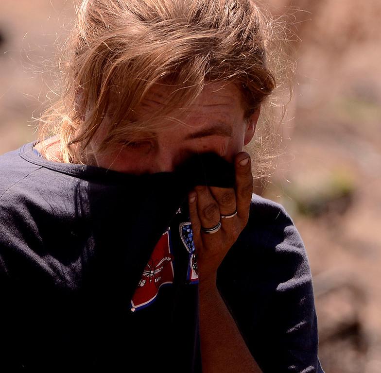 . Dawna Bonner, 30,cries as she emerges from a homeless camp in a vacant lot along Ninth Street in San Bernardino August 14, 2013. GABREL LUIS ACOSTA/STAFF PHOTOGRAPHER.