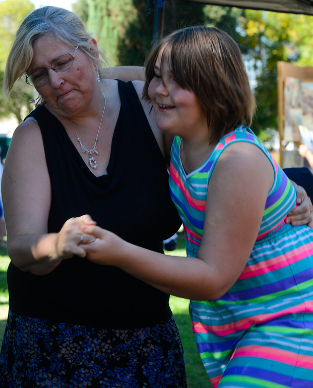 . Redlands residents Pat Moinar, left, and her 9-year-old daughter Samantha Dettloff (cq) dance to folk music played at the Redlands 125th anniversary celebration on Saturday, Nov. 2, 2013. (Photo by Rachel Luna / San Bernardino Sun)