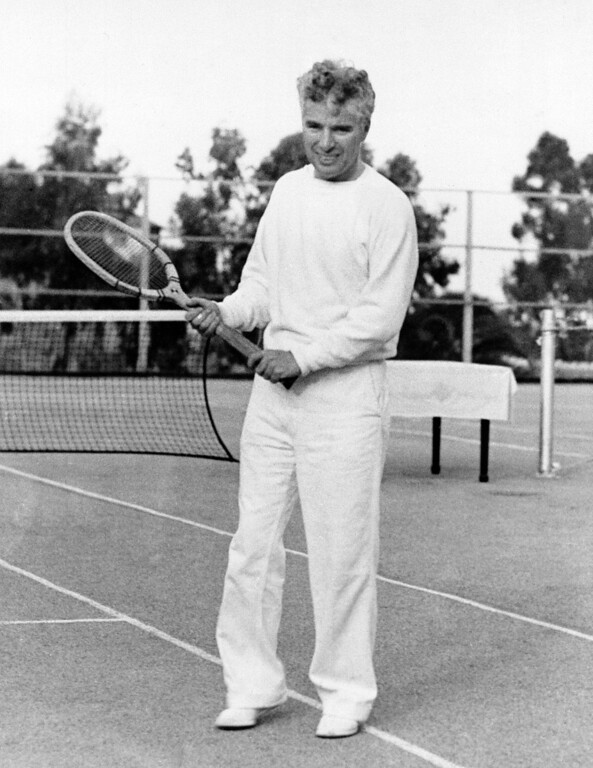 . Tennis is one of Charlie Chaplin�s many accomplishments and he enjoys nothing better than a fast game around sundown on the asphalt courts of Catalina Island, Calif., in an undated photo. (AP Photo)