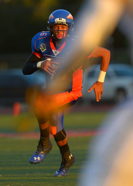 . Westlake High quarterback Malik Henry gains yards against Canyon High August 30, 2013 in Westlake Village, CA.(Andy Holzman/Los Angeles Daily News)
