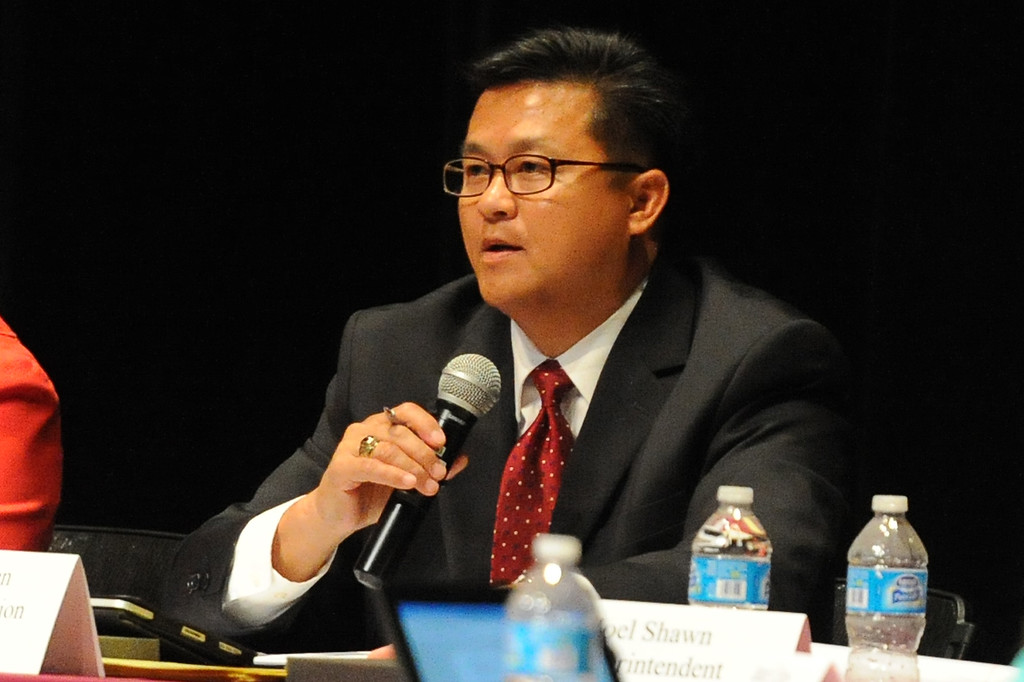. Board of Education President, Cung Nguyen speaks as over 200 people crowded the Arcadia Unified School District Performing Arts Center as a show of support for fired Arcadia High School cross-country coach James O\'Brien during a Arcadia Unified School District Board of Education meeting on Tuesday, July 23, 2013 in Arcadia, Calif. O\'Brien, led the team to two time state and national championships.  (Keith Birmingham/Pasadena Star-News)