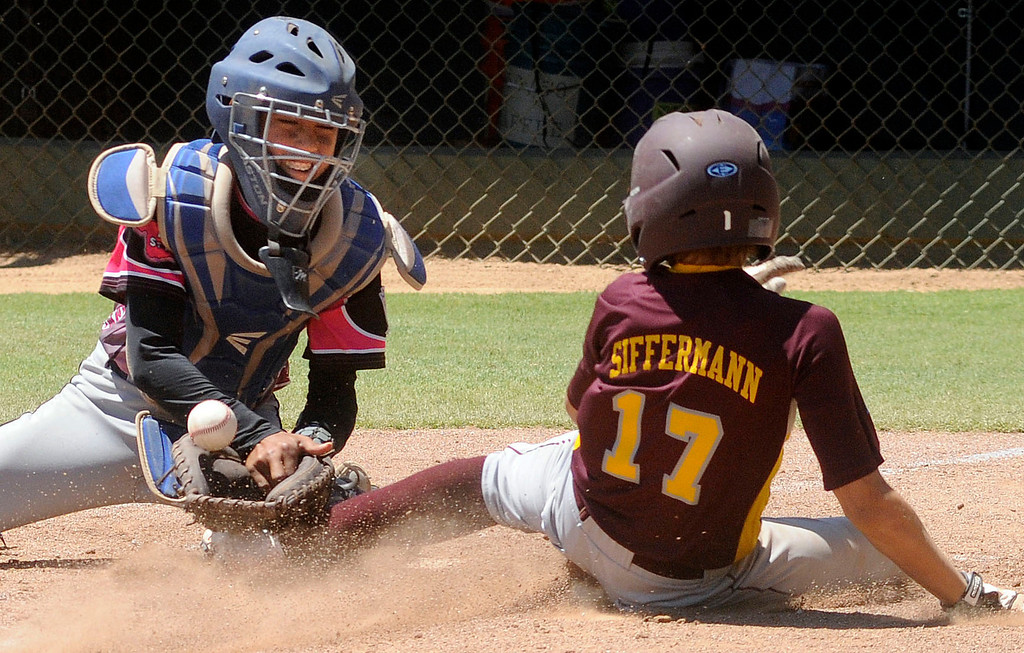 . (Will Lester/Inland Valley Daily Bulletin) Arizona\'a Ty Siffermann scores in the 5th inning as Hawaii catcher Cade Kalehuawehe can not handle the throw Wedneday. Siffermann\'s run was the game winner. Chandler Little League, from Chandler, Arizona, eliminates Central East Maui, from Hawaii, with a 5-3 win Wednesday August 7, 2013 11-3 at the Little League Western Regional Tournament at Al Houghton Stadium in San Bernardino.