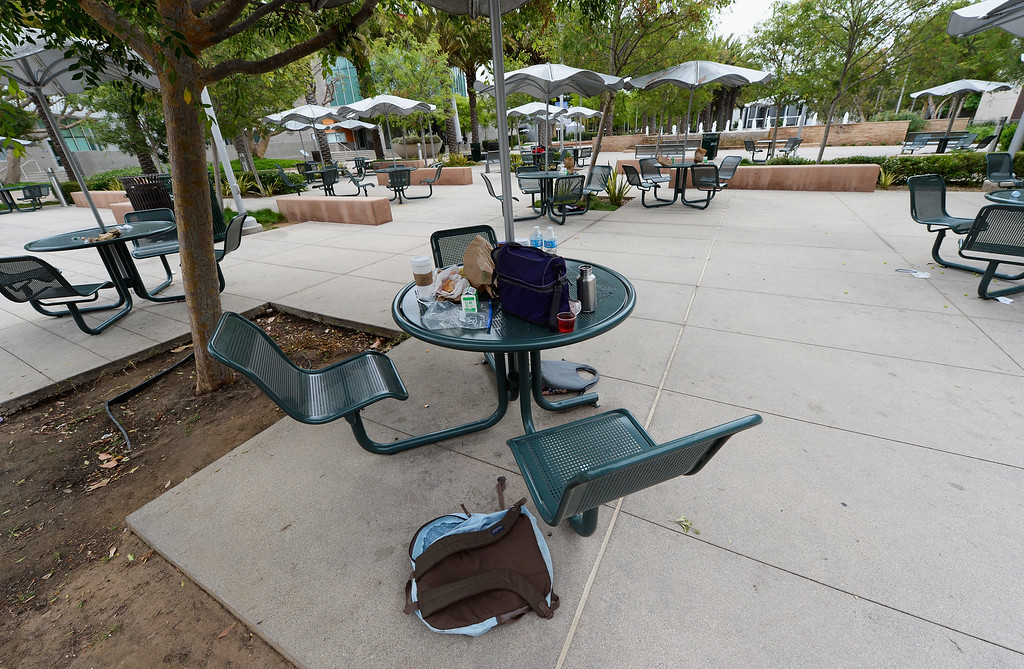 . SANTA MONICA, CA - JUNE 07:  Backpacks and lunch are left behind after students escaped multiple shooting on the campus of Santa Monica College near the library June 7, 2013 in Santa Monica, California. According to reports, at least three people have been injured, and a suspect was taken into custody. (Photo by Kevork Djansezian/Getty Images)
