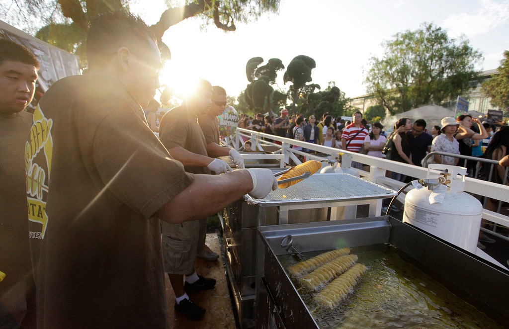 . A long line for Hotato Potato at the 626 night market at Santa Anita Park in Arcadia, Saturday August 3, 2013. (SGVN/Correspondent Photo by Ron Fu/SVCITY)