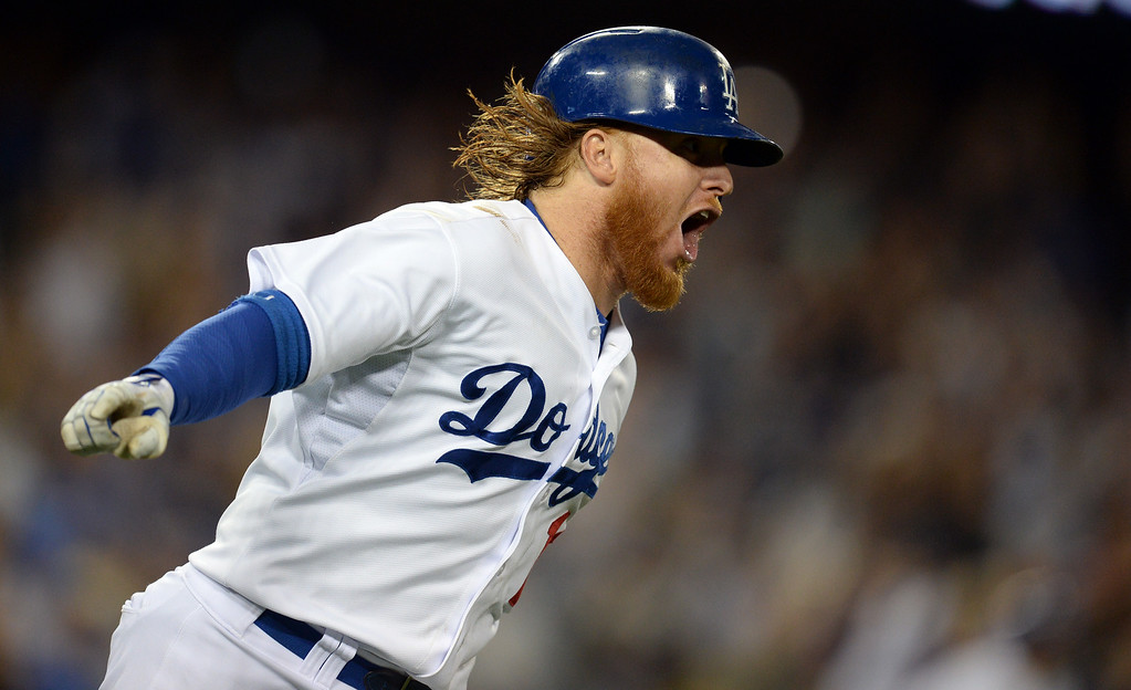 . The Dodgers� Justin Turner #10 reacts as he heads for first base on his 2-run homer in the 8th inning during their game against the Padres at Dodger Stadium Thursday, August 21, 2014. (Photo by Hans Gutknecht/Los Angeles Daily News)