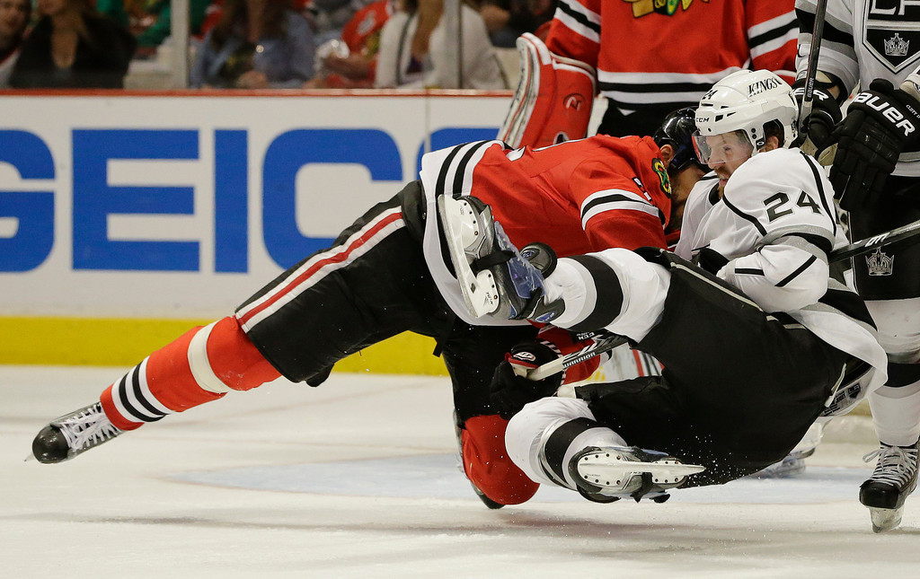 . Chicago Blackhawks defenseman Michal Rozsival (32) pulls down Los Angeles Kings center Colin Fraser (24) during a fight during the third period of Game 2 of the NHL hockey Stanley Cup Western Conference finals, Sunday, June 2, 2013, in Chicago. Chicago won 4-2. (AP Photo/Nam Y. Huh)
