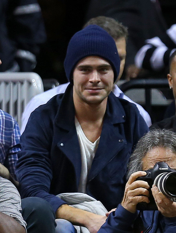 . Zac Efron watches a game between the Miami Heat and the Los Angeles Lakers during a game  at American Airlines Arena on January 23, 2014 in Miami, Florida.  (Photo by Mike Ehrmann/Getty Images)