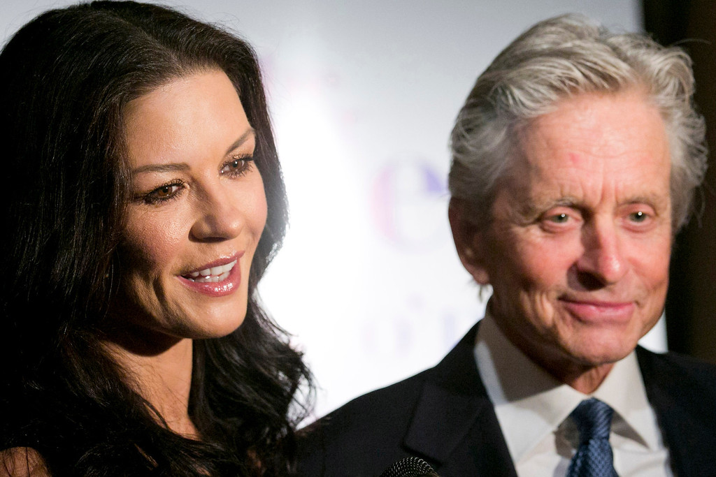 . Honoree Michael Douglas and his wife Catherine Zeta-Jones attend the Eugene O\'Neill Theater Center\'s 12th Annual Monte Cristo Awards in New York, Monday, April 16, 2012. (AP Photo/Charles Sykes)