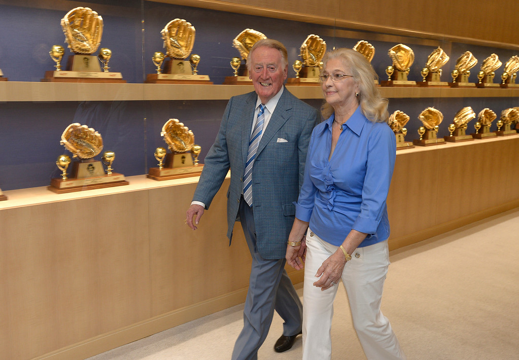. Vin Scully and his wife Sandy Scully walk down the hall after holding a press conference at Dodger Stadium. Scully, a Hall of Fame broadcaster, will return to the Dodger broadcast booth for an unprecedented 66th season in 2015. The announcement was made by several Dodger players on Dodger Vision during last night�s game against the Atlanta Braves. Los Angeles, CA. 7/30/2014(Photo by John McCoy Daily News)