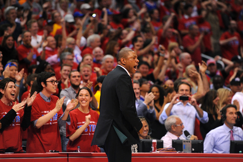 . Clippers coach Doc Rivers celebrates with fans in their 126-121 win over the Warriors in game seven of the Western Conference playoffs, Saturday, May 3, 2014, at Staples Center. (Photo by Michael Owen Baker/L.A. Daily News)
