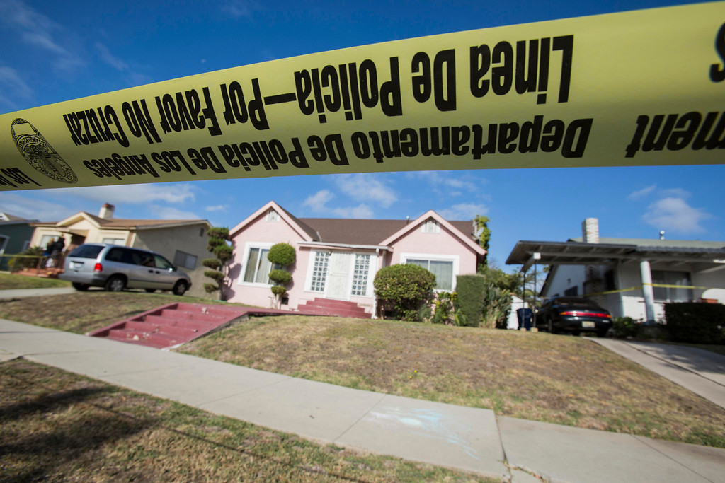 """. Yellow police tape seals off the home of actor Michael Jace on Tuesday, May 20, 2014, in Los Angeles.  Jace, who played a police officer on the hit TV show \""""The Shield,\"""" was arrested on suspicion of homicide after his wife was found shot to death in their Los Angeles home, authorities said. Police arrived at the couple\'s home around 8:30 p.m. Monday after a report of shots fired, Officer Chris No said. April Jace, 40, was found dead inside, officials said.  Jace was taken into custody and booked early Tuesday on suspicion of homicide, No said. He was being held in a Los Angeles jail in lieu of $1 million bail.   (AP Photo/Ringo H.W. Chiu)"""