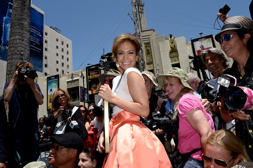 . US actress, singer Jennifer Lopez (C) poses with her star on the Hollywood Walk of Fame during ceremony in Hollywood, California, USA 20 June 2013. Lopez was awarded the 2,500th star on the Hollywood Walk of Fame in the category of Recording.  EPA/PAUL BUCK