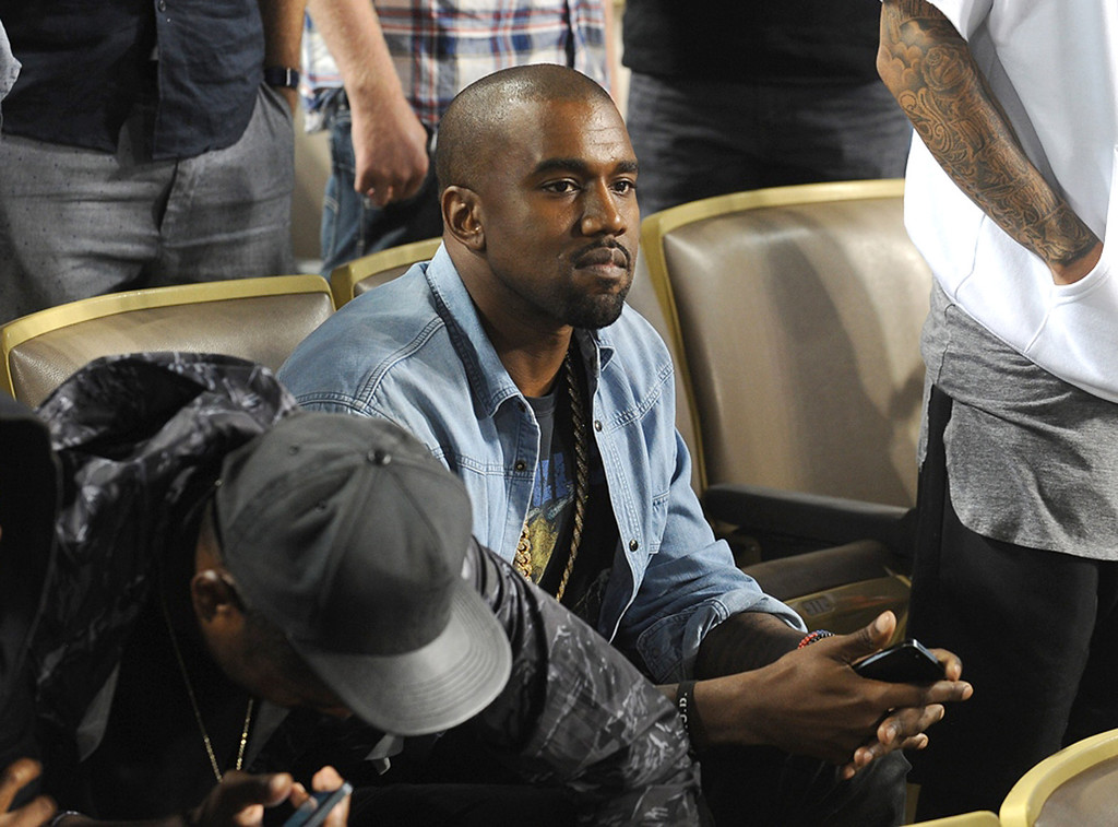 . In this handout photo provided by the Los Angeles Dodgers, Kanye West attends the New York Mets v Los Angeles Dodgers game at Dodger Stadium on August 14, 2013 in Los Angeles, California. (Photo by Juan Ocampo/Los Angeles Dodgers via Getty Images)