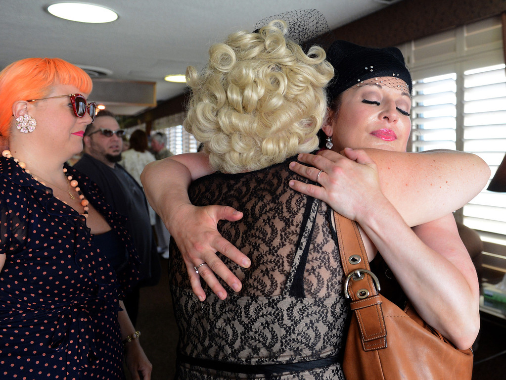. Burlesque performers Dr. Lucky and Kitten On The Keys embrace as friends and family arrive for a memorial service for Dixie Evans Sunday, September 1, 2013, at Palm Mortuary in Las Vegas. Jennifer Cappuccio Maher/Inland Valley Daily Bulletin