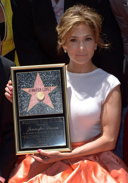 . US actress, singer Jennifer Lopez with her star on the Hollywood Walk of Fame during ceremony in Hollywood, California, USA, 20 June 2013. Lopez was awarded the 2,500th star on the Hollywood Walk of Fame in the category of Recording.  EPA/PAUL BUCK