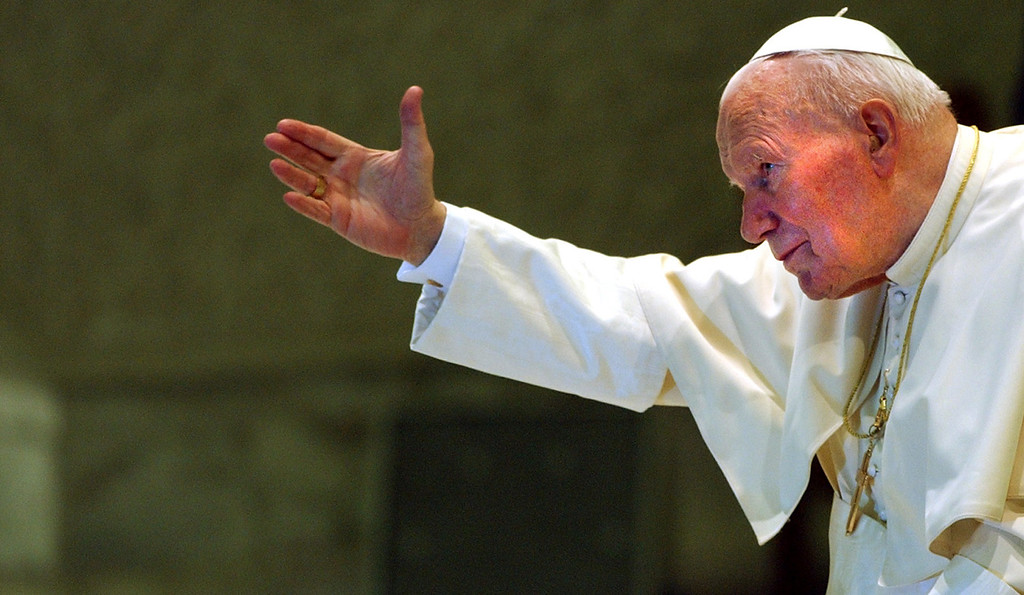. Pope John Paul II gestures during his weekly general audience in the Paul VI hall at the Vatican, in this Sept. 4, 2002 file photo. (AP Photo/Pier Paolo Cito, File)
