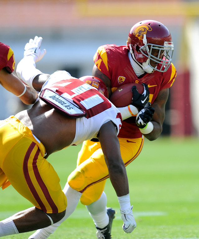 . USC LB Jabari Ruffin hits WR Darreus Rogers during their spring game, Saturday, April 19, 2014, at the Coliseum. (Photo by Michael Owen Baker/L.A. Daily News)