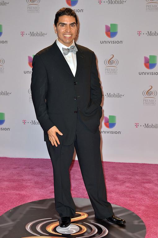 """. MIAMI, FL - FEBRUARY 21:  Piolin arrives at the 25th Anniversary Of Univision\'s \""""Premio Lo Nuestro A La Musica Latina\"""" on February 21, 2013 in Miami, Florida.  (Photo by Gustavo Caballero/Getty Images for Univision)"""