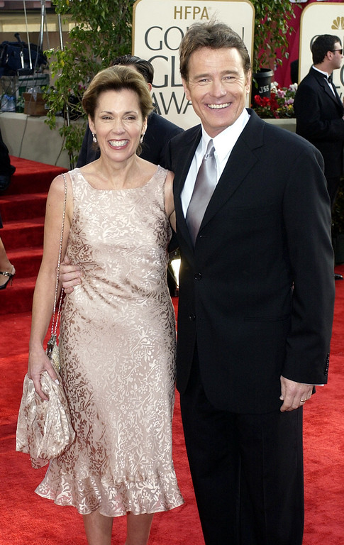 ". Bryan Cranston, nominated for best performance by an actor in a supporting role in a series, mini-series or motion picture made for television for his work in ""Malcolm in the Middle,\"" arrives with his wife Robin Dearden for the 60th Annual Golden Globe Awards, in Beverly Hills, Calif., Sunday, Jan. 19, 2003. (AP Photo/Mark J. Terrrill)"