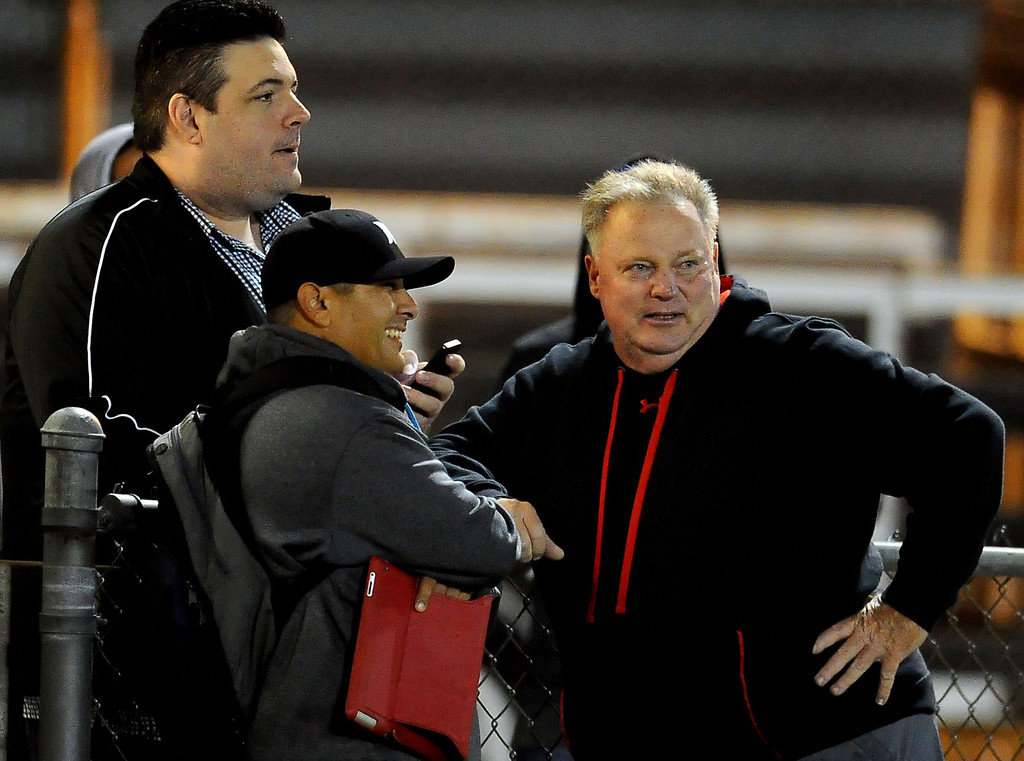 . Reporters Aram Tolegian, left, along with Fred Robledo talk with former Los Altos, Damien and Tustin head coach, Greg Gano in the first half of a prep football game between Charter Oak and South Hills at Covina DIstrict Field in Covina, Calif., on Thursday, Oct. 24, 2013. 