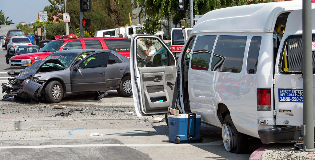 . Several mentally-disabled adults and occupants of a second vehicle were injured when a van carrying seven people collided with a Toyota Camry traveling southbound on Workman Mill Road at Lomitas Avenue in the city of Industry May 9, 2013.   (SGVN/Staff photo by Leo Jarzomb)
