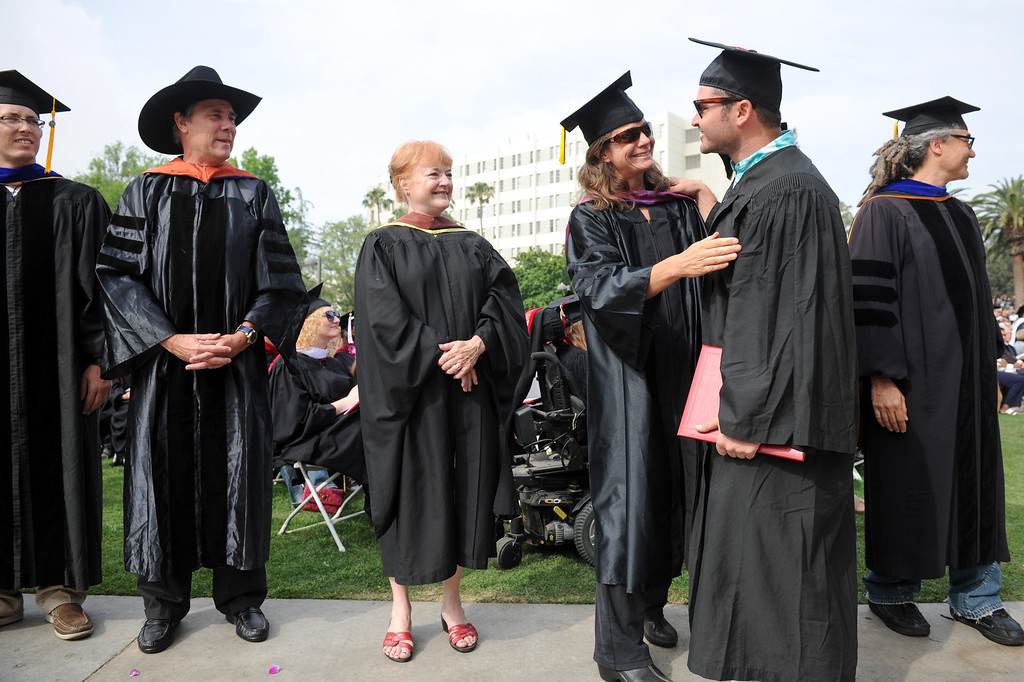 . Communications Studies teachers congratulate graduates at the CSUN commencement ceremony, Tuesday, May 21, 2013. (Michael Owen Baker/L.A. Daily News)