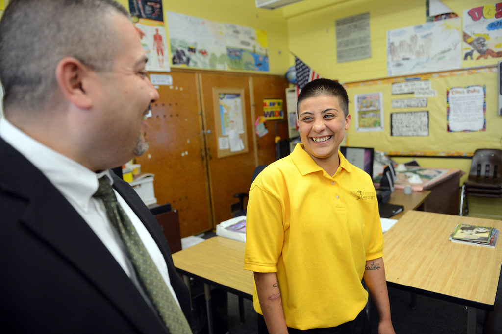 . LACO Senior Probation Director for Education Services Jesus Corral talks with Alma Reyna, 18-years-old, about the Road to Success Academy at Probation Camp Scott in Santa Clarita Wednesday, May 22, 2013. (Hans Gutknecht/Los Angeles Daily News)