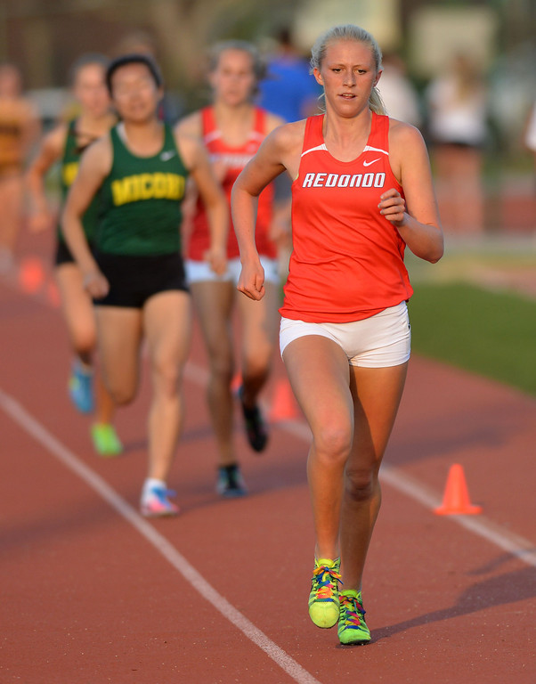 . 05-03-2013-(LANG Staff Photo by Sean Hiller)-  The Bay League track and field finals Friday night at Mira Costa High School. Redondo\'s  Kayla Ferron takes first in the girls varsity 1600.