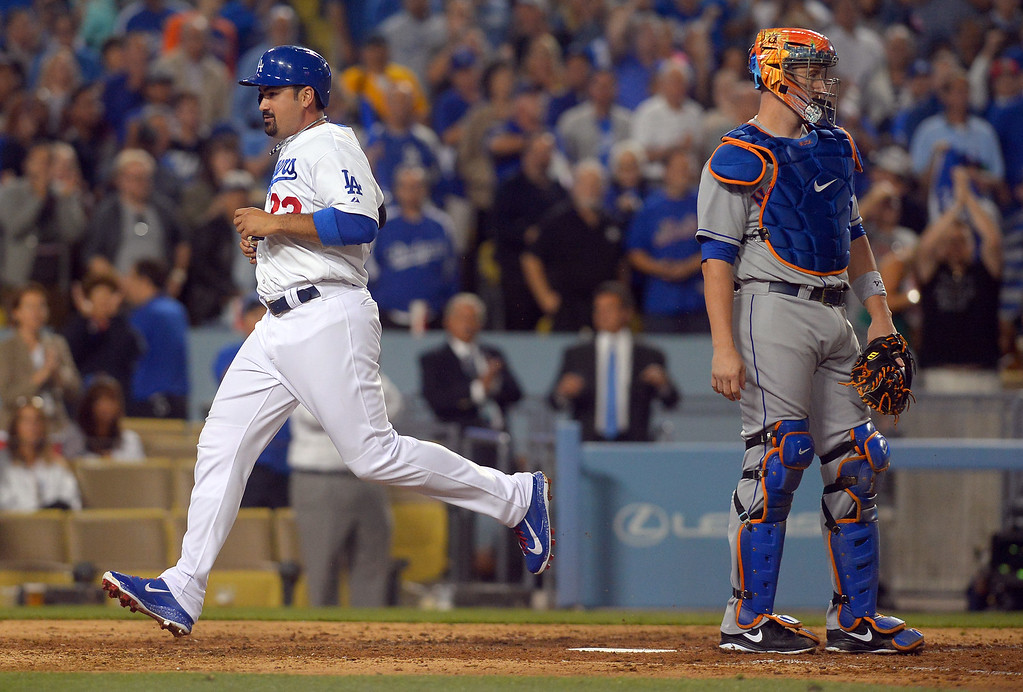 . Dodgers Adrian Gonzalez crosses the plate after tagging up on a fly ball hit by Yasiel Puig in the 6th inning against the Mets August 12, 2013.  The Dodgers scored three runs in the inning.(Andy Holzman/Los Angeles Daily News)