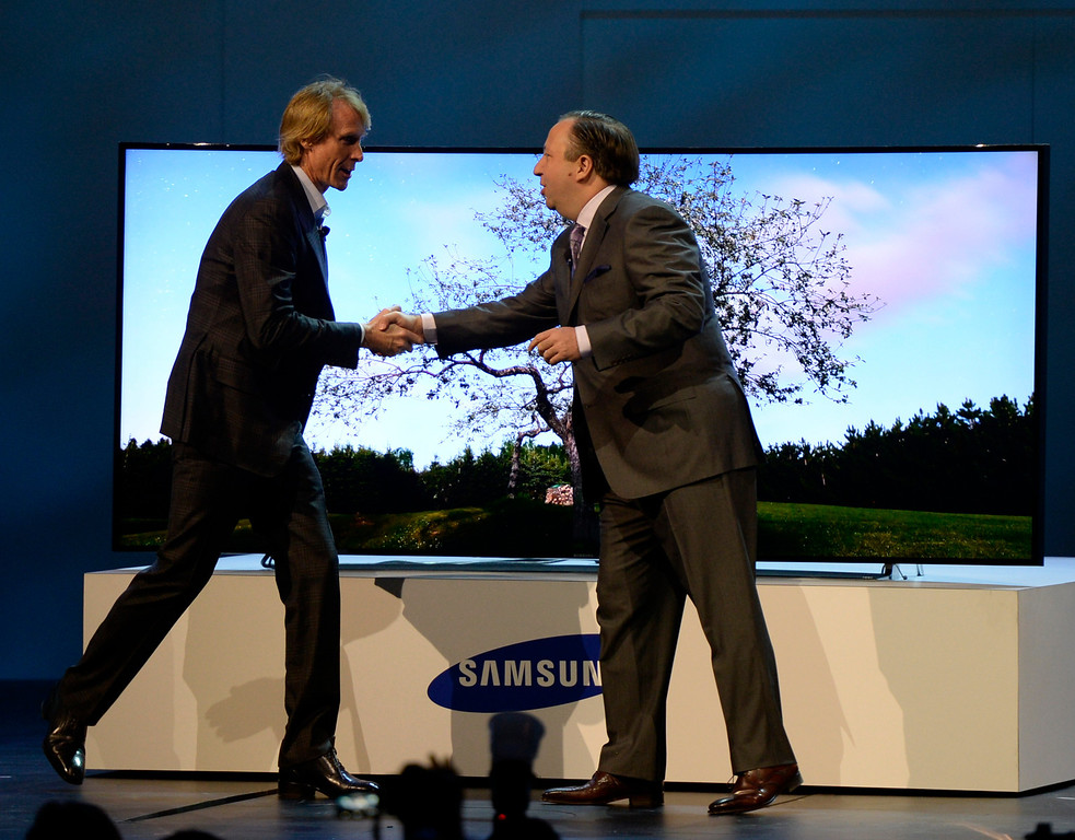 . Jan 6,2014.  Las Vegas NV. USA. Samsung executive vice president Joe Stinziano(R.) greets director Michael Bay who later just walked on stage, flubbed his lines, and walked off during the Samsung CES press conferences   Monday. The 2014 CES show starts this Tuesday and runs till Friday with a estimated crowd of 150,000 to attend the show.. Photo by Gene Blevins/LA Dailynews