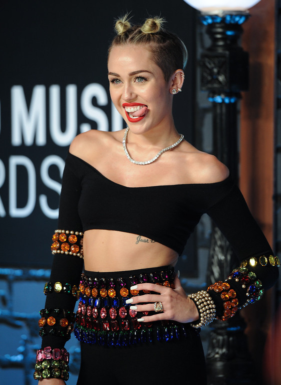 . Singer Miley Cyrus arrives at the MTV Video Music Awards on Sunday, Aug. 25, 2013, at the Barclays Center in the Brooklyn borough of New York. (Photo by Evan Agostini/Invision/AP)