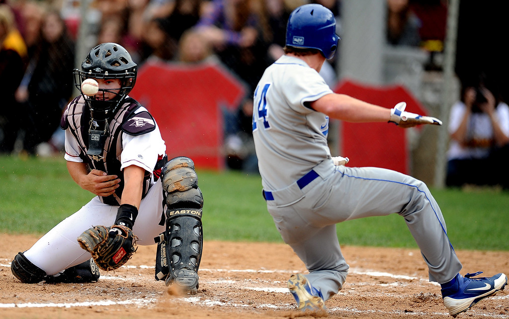 . San Marino\'s Matt Wofford (14) scores past La Canada catcher Johnny Selsor in the second inning of a prep baseball game at La Canada High School on Wednesday, March 8, 2013 in La Canada, Calif. La Canada won 3-2.  (Keith Birmingham Pasadena Star-News)   q