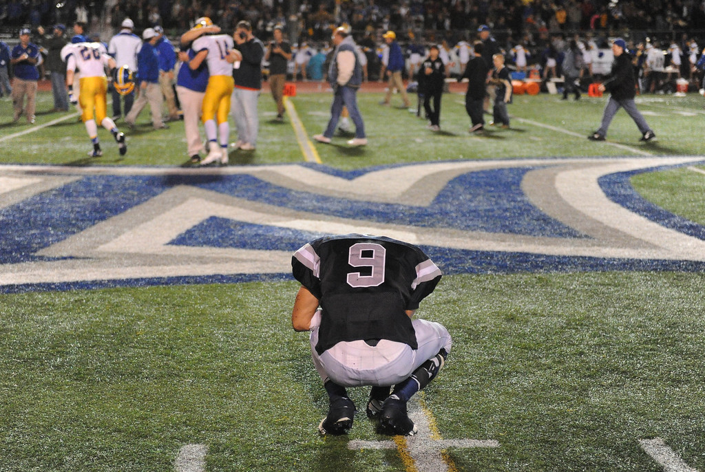 . North 9 Michael Jurado alone at midfield at Nordhoff players celebrate victory over North #!-14.North Torrance vs Nordhoff High School CIF Southern Sect. Northwest championship. 12-1-12. Photo by Brad Graverson/LANG