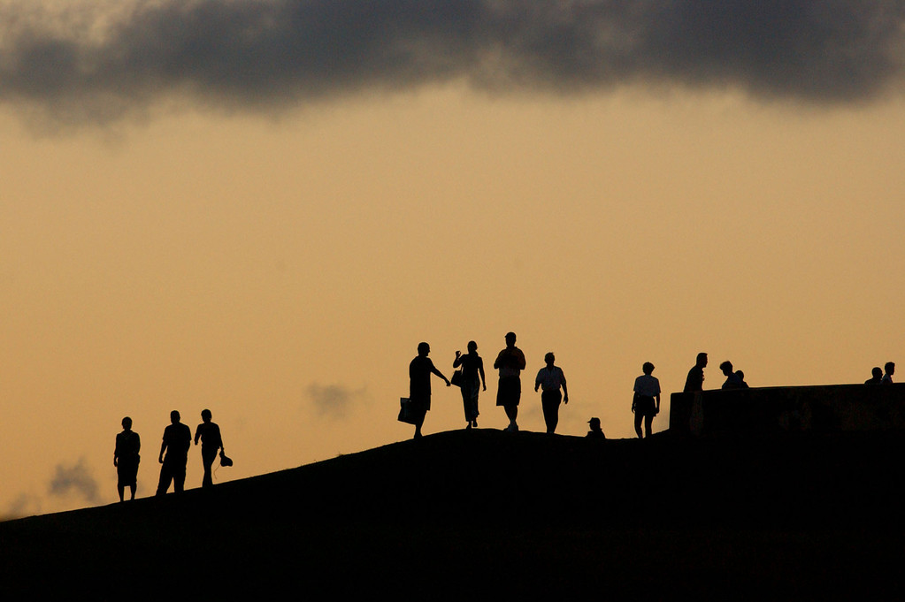 . Tourists line up to watch the sun set in Old San Juan, Puerto Rico on Monday, April 7, 2003.  (AP Photo/ Tomas van Houtryve)