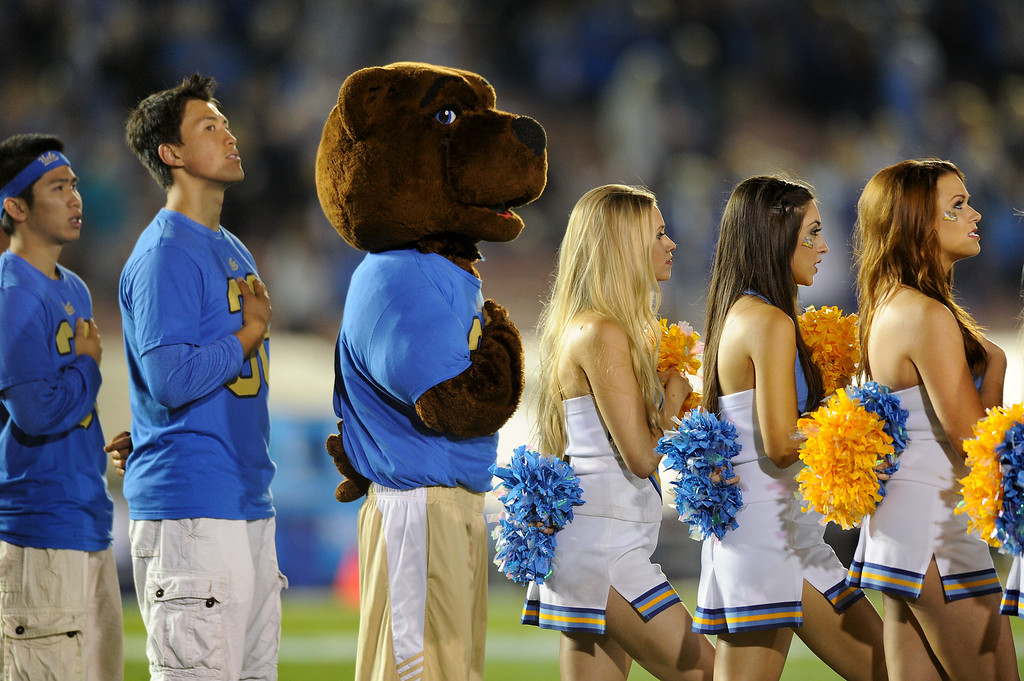 . UCLA mascot and cheerleaders stand for the national anthem before their game against New Mexico State, Saturday, September 21, 2013, at the Rose Bowl. (Photo by Michael Owen Baker/L.A. Daily News)