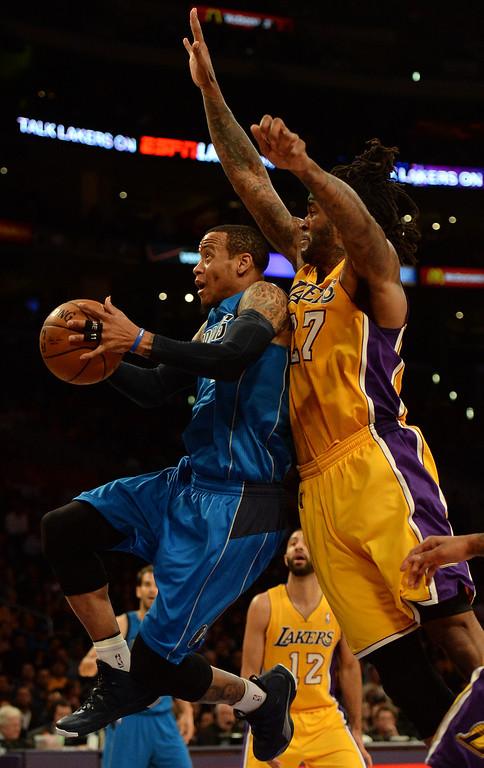 . Dallas Mavericks guard Monta Ellis drives past Los Angeles Lakers forward Jordan Hill (27) in the second half during an NBA basketball game in Los Angeles, Calif., on Friday, April 4, 2014. Dallas Mavericks won 107-95.  (Keith Birmingham Pasadena Star-News)