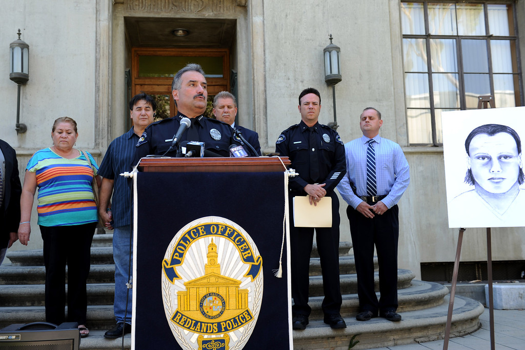 . (John Valenzuela/Staff Photographer) Redlands Police Chief Mark Garcia gives an update in the murder investigation of Sylvia Flores, as her parents Sylvia and Robert Flores and other law enforcement officals listen, during a press conference outside the police annex in Redlands, CA.Tuesday, September 12, 2013. Flores, a 23-year-old woman from Perris, CA. who\'s body was found in a orange groves near Citrus Plaza shopping center in Redlands.