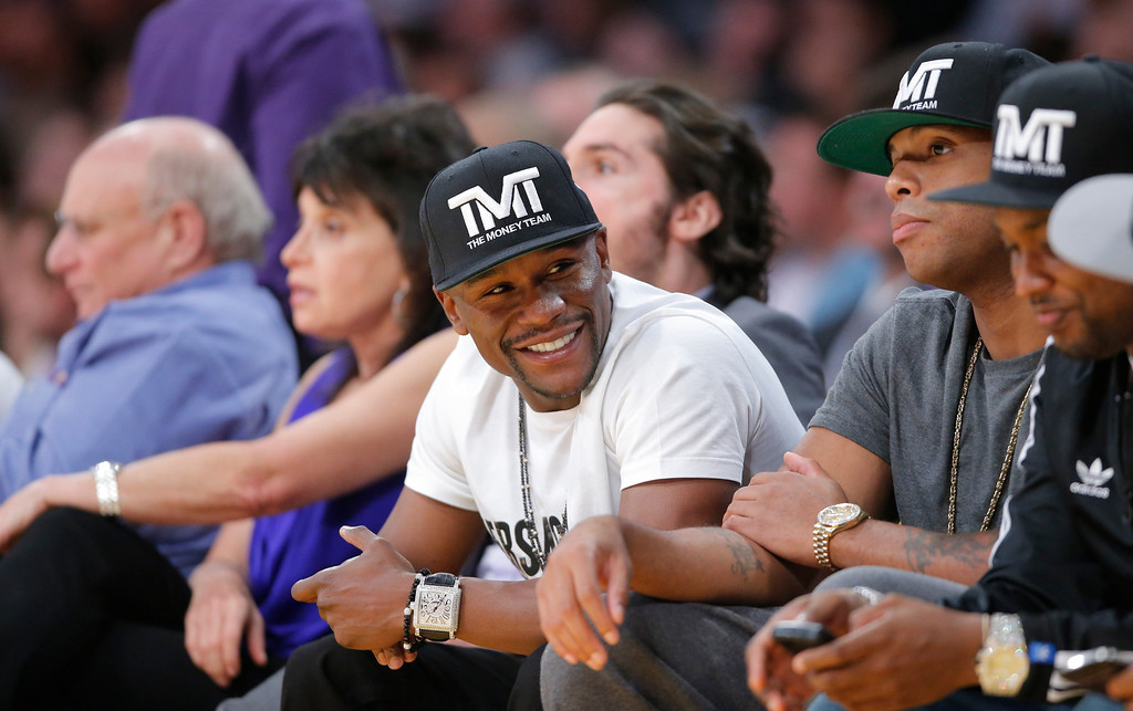 . Boxer Floyd Mayweather Jr. in the second half of an NBA basketball game between the Los Angeles Lakers and the San Antonio Spurs in Los Angeles, Tuesday, Nov. 13, 2012. The Spurs won 84-82. (AP Photo/Jae C. Hong)