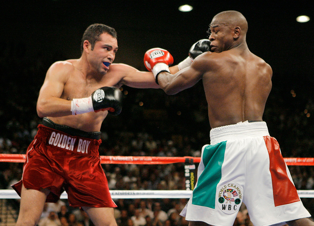 . Oscar De La Hoya, left, lands a left on Floyd Mayweather Jr. during the second round of their WBC super welterweight world championship boxing match on Saturday, May 5, 2007, at the MGM Grand Garden Arena  in Las Vegas. (AP Photo/Jae C. Hong)