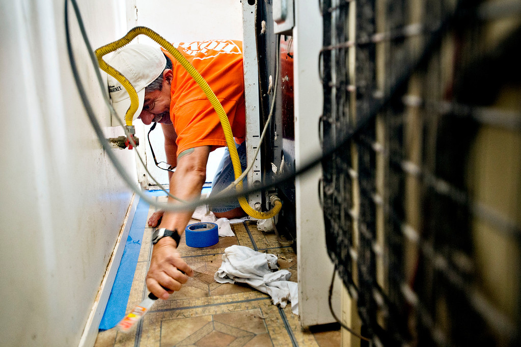 . Home Depot volunteer Ray Herrera preps before painting in the kitchen for a veteran, Fidel Sanchez, a member of VFW Post 8070, at his Azusa home on Friday morning, Nov. 8, 2013. The volunteers will help cleanup, paint and install new appliances in the kitchen. (Photo by Watchara Phomicinda/San Gabriel Valley Tribune)