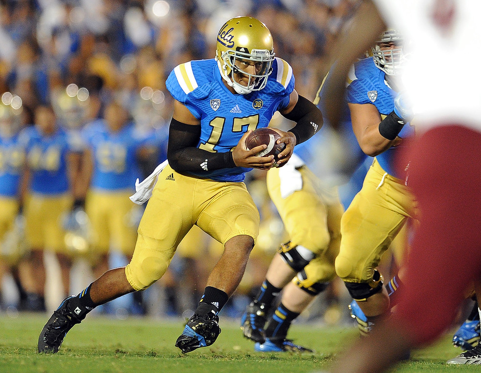 . UCLA quarterback Brett Hundley scrambles against New Mexico State during the first half of their college football game in the Rose Bowl in Pasadena, Calif., on Saturday, Sept. 21, 2013.   (Keith Birmingham Pasadena Star-News)