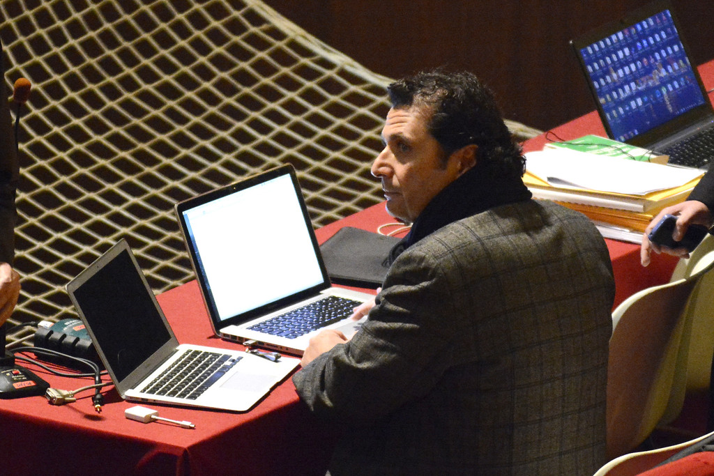 . Francesco Schettino sits in front of two laptops during a pause of his trial at the Grosseto court, Italy, Monday, Feb. 9, 2015. Whatever verdict is delivered in the trial of the Italian sea captain for the shipwreck of the Costa Concordia cruise liner and for the deaths of 32 people, survivors and victims\' families already are wondering if justice will be done. The trial, expected to bring a verdict this week, has a sole defendant. Francesco Schettino is accused of causing the shipwreck on the night of Jan. 13, 2012, when he steered too close to a tiny Tuscan island, smashing into a granite reef that sliced open the hull, sending seawater rushing in. (AP Photo/Giacomo Aprili)