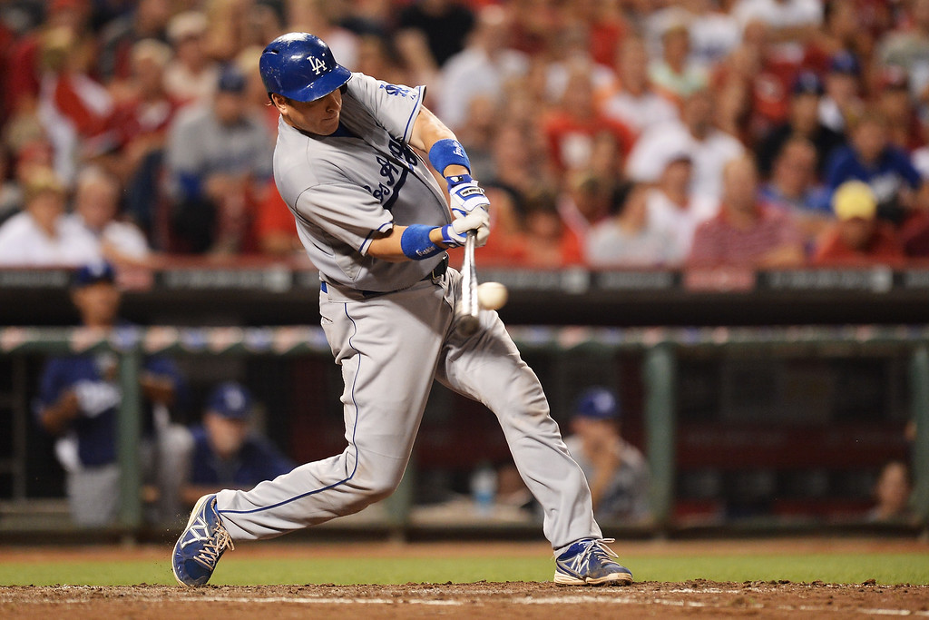 . CINCINNATI, OH - SEPTEMBER 8:  A.J. Ellis #17 of the Los Angeles Dodgers connects for a single in the fifth inning against the Cincinnati Reds at Great American Ball Park on September 8, 2013 in Cincinnati, Ohio. Cincinnati defeated Los Angeles 3-2 to sweep the series.  (Photo by Jamie Sabau/Getty Images)