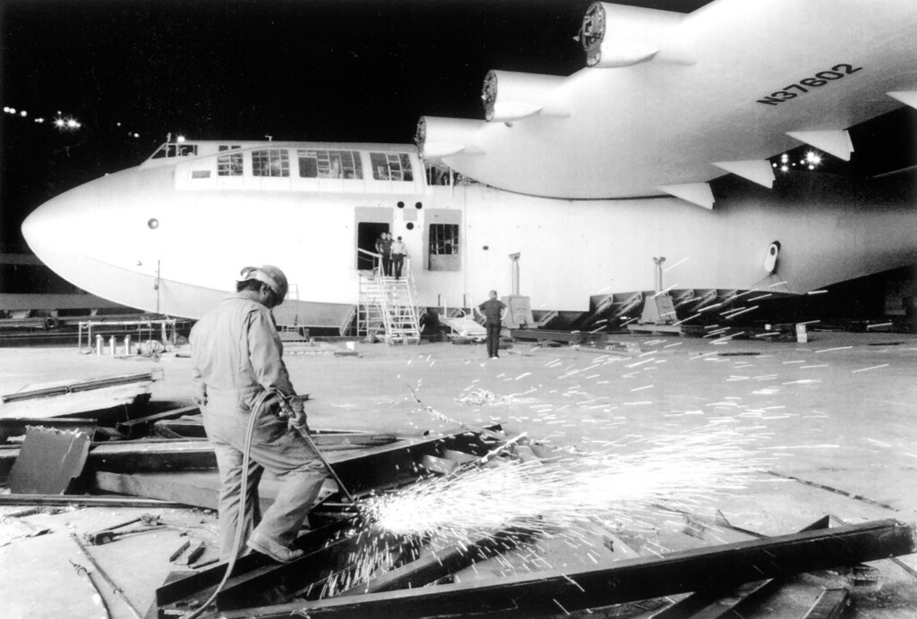 . Workers begin dismantling the historic Hughes Flying Boat in Long Beach. The Spruce Goose was cut up into 38 separate elements and moved by land and sea to its new home at the Evergreen AirVenture Museum in McMinnville, OR. (9/16/92)   Los Angeles Daily News file photo