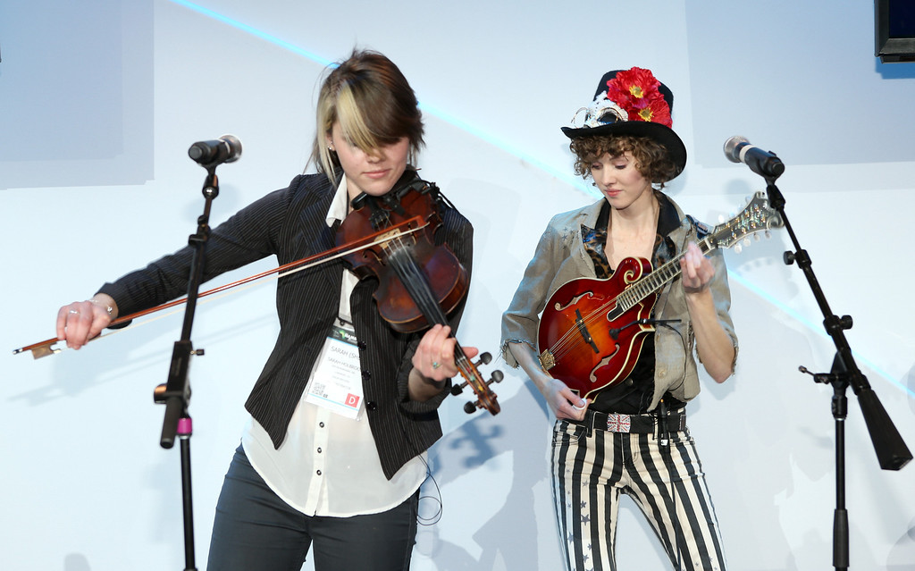 . ANAHEIM, CA - JANUARY 22:  Eva Holbrook and Sarah Holbrook  of SHEL perform for Weber Fine Instruments at the 2014 National Association of Music Merchants show media preview day at the Anaheim Convention Center on January 22, 2014 in Anaheim, California.  (Photo by Jesse Grant/Getty Images for NAMM)