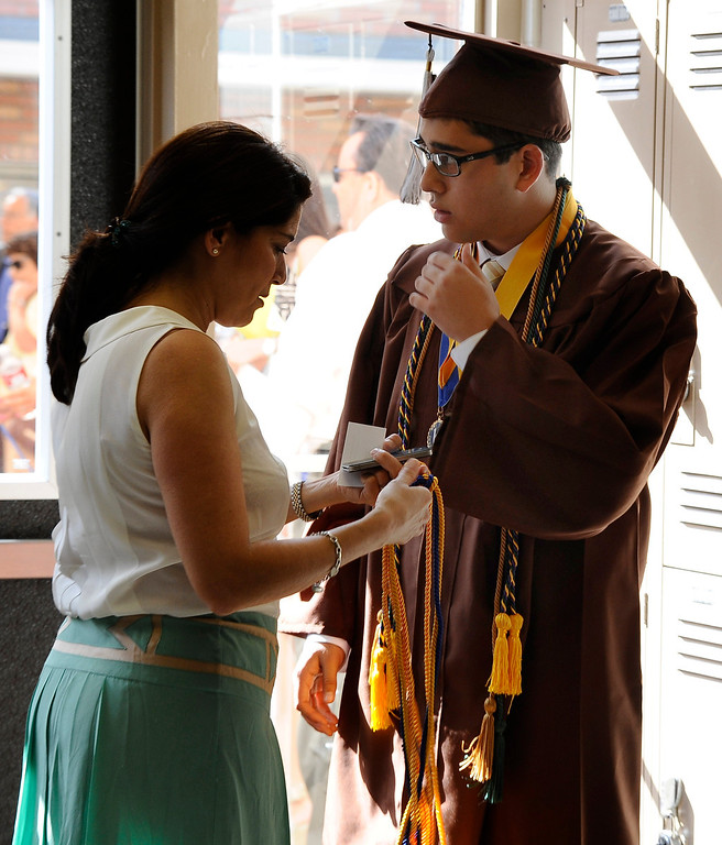 . Grads get some last minute touching up the cap and gown during the Crespi High class of 2013 graduation. May 24.2013.  Photos by Gene Blevins/LA DailyNews