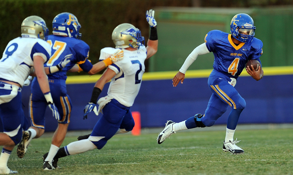 . Bishop Amat quarterback Koa Haynes (C) (4) runs for a first down against Santa Margarita in the first half of a prep football game at Bishop Amat High School on Friday, Aug. 30, 2013 in La Puente, Calif.   (Keith Birmingham/Pasadena Star-News)