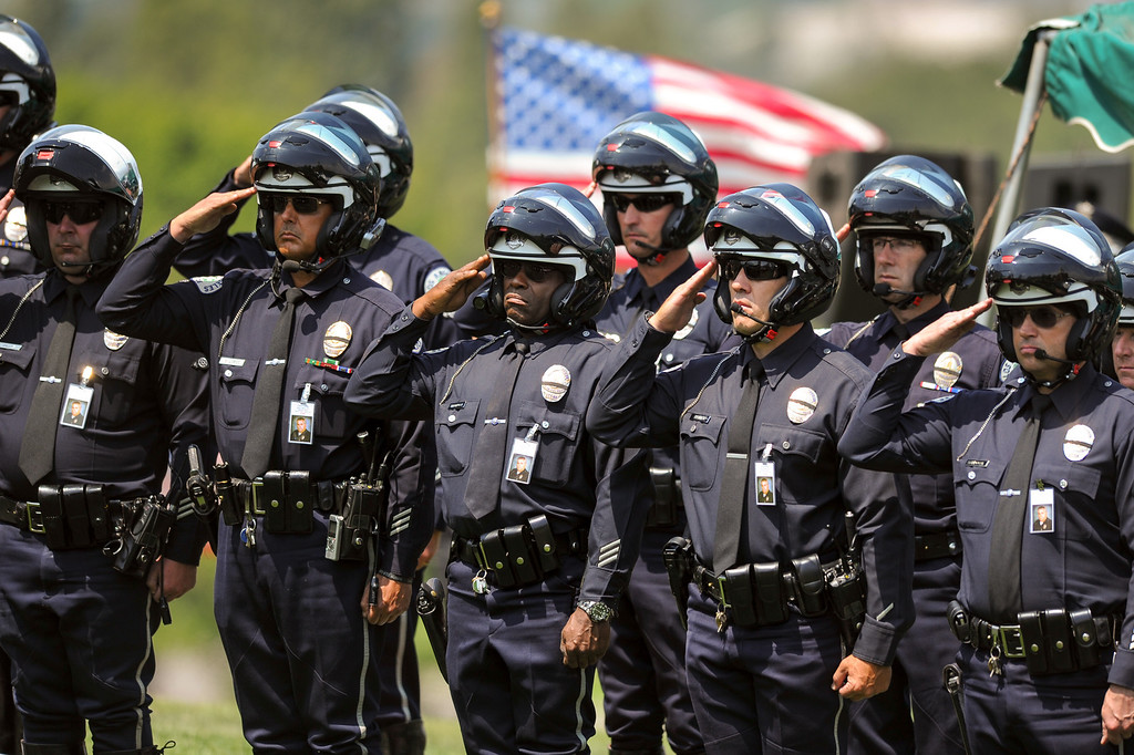 . LAPD officers salute at the burial of LAPD officer Chris Cortijo, Tuesday, April 22, 2014, at Forest Lawn Hollywood Hills. (Photo by Michael Owen Baker/L.A. Daily News)