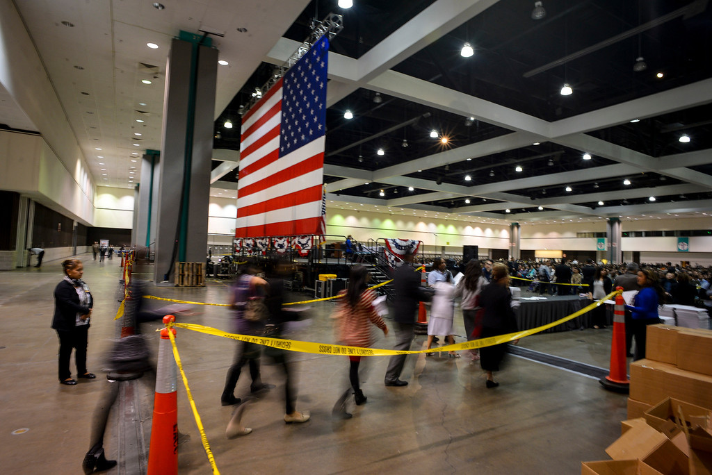 . US Citizen candidates file in to the Los Angeles Convention Center for swearing in ceremonies Tuesday, December 17, 2013.  3,793 immigrants were sworn in as New US citizens at the ceremony.  ( Photo by David Crane/Los Angeles Daily News )